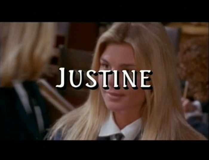 "Justine, a blonde college girl, is completely obscured by the word ""JUSTINE"" in obtrusive white text."
