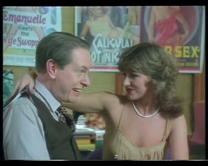 Kenneth Williams' stunt double meets some woman with a mullet.